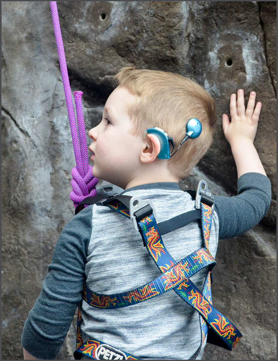Young boy with cochlear implant attending a Climbing for Kids Event.