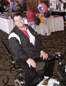 Man in a scooter at the 2019 Tools for Life Conference.