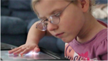 Young girl with touchpad.